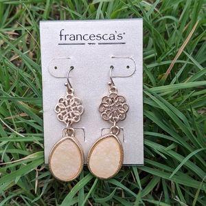 Gold Ivory Dangling Earrings from Francesca's